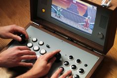 Keeping up with the theme of retro with a modern twist, this wooden casing that holds a 2 player arcade system with a monitor all in one box. Arcade Bartop, Arcade Console, Portable Game Console, Arcade Stick, Gaming Station, Retro Arcade, Arcade Machine, Usb, Latest Games
