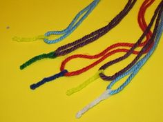 Use a pipe cleaner as a needle twisted around the yarn to sew lacing cards with.