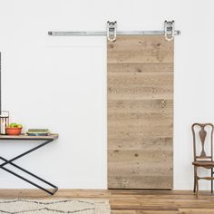The Weathered Panel Barn Door is made from hand-picked reclaimed lumber with a metal frame to give a contemporary rustic look and feel. Buy yours today!