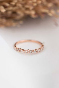 Our best selling diamond band, the Petite Cluster, is all things dainty, elegant and organic. Shown here in 14k rose gold, this ring looks stunning as a wedding band or in any ring stack. Available in eternity or half-eternity styles and 14k or 18k yellow gold, white gold, rose gold or platinum.