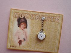 dollhouse miniature pretty pearl and rhinestone watch pin and/ or pocket watch on a French Nouveaute card