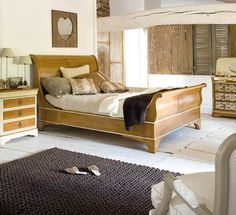 Cozy, rustic bedroom by Grange. Add a wall of barn wood?  Or old wooden window panels on one wall?