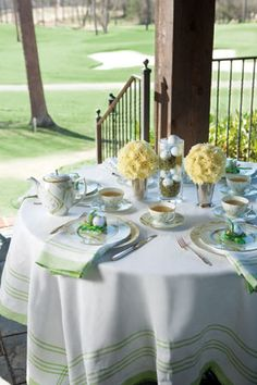 """Golf balls in the center flanked by two full """"ball"""" arrangements. Note, even with carnations, full flower balls are not the least expensive but they do create a fun look!"""