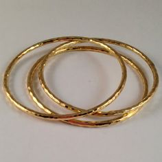 B00010 $125  Hammered gold vermeil bangles//www.theodosiajewelry.com