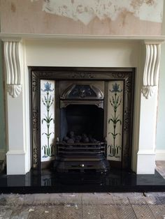 Gas Fire with cast iron and tiled inset, wood surround and Marble hearth.