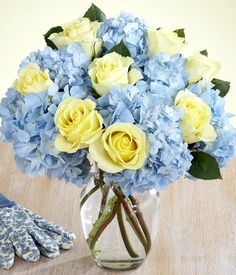 blue hydrangeas and light yellow roses.