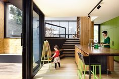 Park life: Clifton Hill House. An integrated stair/joinery spine connects the lower level kitchen and upper level spaces.