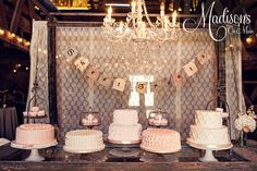 Shabby Chic Wedding Cake Table...... - My bride opted to do a cake table, rather than a large tiered cake. I did 5 different designs in buttercream, and then lace wrapped cupcakes. The bride used an old door that she turned into a table for the cake table, and the entire decor was a knockout in shades of ivory, pink, and peach.