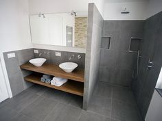 We like the round white basins and the double shelf concept (not quite what we had looked at before). Open ended shelves which do not drop down to floor. On a separate we also like the grey for the smaller bathroom. In here, can we have floor tiles that go up the walls as well? Like in this picture, with a white paint higher up