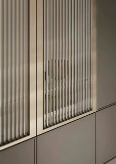 Cabinetry; ribbed glass, gold framing, taupe finish