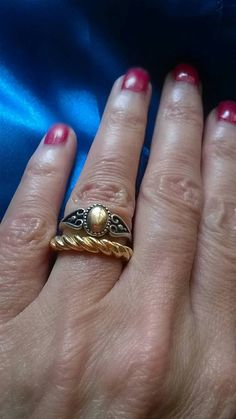 This is such a pretty little ring. Hallmarked for 14k gold and sterling silver. The gold is used in the centre to give the impression of a stone. Ring size K and 3/4, US size 5 and 3/4. The gold oval is a little over a quarter of an inch tall. It has a Victorian look to it. The other ring is not included in the sale.