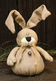 This tall vintage burlap bunny has bendable ears, raffia, bell accents, and a weighted bottom. The perfect addition to your Easter decor. This bunny will love to be placed anywhere around your home. Burlap Projects, Burlap Crafts, Sewing Projects, Diy Crafts, Bunny Crafts, Easter Crafts, Diy Ostern, Country Crafts, Primitive Crafts
