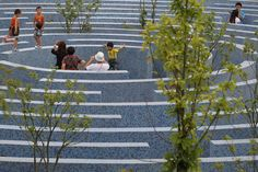 "How extraordinary, a mosaic tiled maze!   ""Visitors walk in a maze during alarge party for the 9th National Traditional Games of Ethnic Minorities of the People's Republic of China, Sept. 15, 2011 in Guiyang, China. (Feng Li/Getty Images)"""