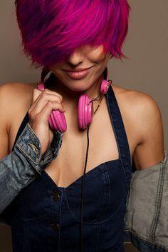 dark pink short hair cut with purple tint & side bangs.