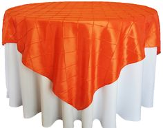 Tangerine Pintuck Table Overlay provided by Waterford Event Rentals.