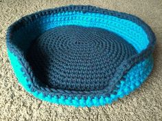 Finally! A sturdy cat bed that doesn't slouch. This cat bed includes strong walls crocheted with two strands of super bulky yarn and reinforced with a wire frame. Along with the crochet patte…