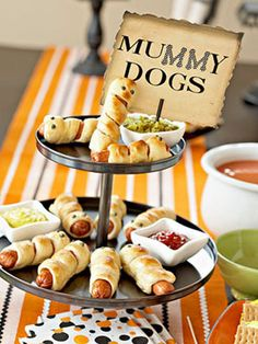 Image via Better Homes and Garden - Ohhhh, WEENIES!  I really want to make these for a Halloweenie party.  Maybe for the Gee's this year.  So cute!  oxoxox