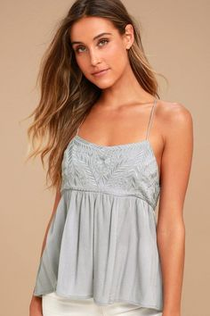 We are dreaming of going on picnics in the park wearing the Absolute Adoration Light Grey Embroidered Top! Woven rayon (with blue undertones) shapes an embroidered babydoll bodice with adjustable, braided straps that cross and tie at back. Elastic at back for fit.