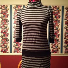 Black and grey stripe Juicy Couture shirt Black and grey stripe Juicy Couture shirt in size Petite with belt loop and quarter length sleeve Juicy Couture Tops