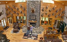 Lee and Tiffany Lakosky show off the great room of their home, which also serves as the main part of their deer camp in Iowa. (Steve Bowman ...