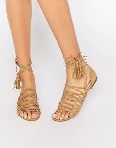 New Look always gets us tied up with their Strappy Detail Tie Up Flat Sandals.