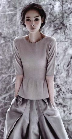 Mix metals. Cashmere with full skirt.