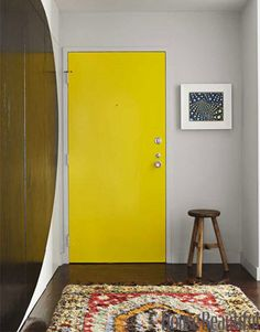 In small apartments you have to create dramatic moments that offset the lack of detail but don't hog the space.Bold yet simple graphic gestures like this look cool in small spaces and require less time money and materials, Painted Interior Doors, Entryway Paint Colors, Yellow Doors, Bold Decor, Tiny Entryway, Beautiful Homes, Yellow Painted Furniture, Yellow Front Doors, Yellow Decor Living Room
