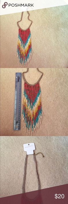 Beaded tribal necklace New with tags. Beautifully beaded and lovely for summer. Adjustable length. Shortest length from top to bottom: 17 inches. Length of collar area not including dangling beads: 9 inches. Limited edition, not sold in stores anymore. Charming Charlie Jewelry Necklaces