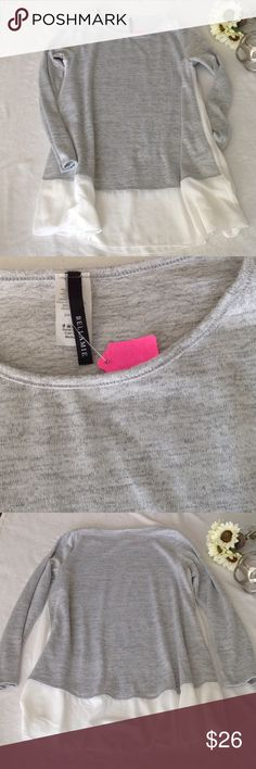 NWT boutique grey top with flowy ivory bottom NWT, has pockets, runs large, lots of flowy fabric, heathered grey with ivory chiffon-like at the bottom and sides, has pockets Bellamie Tops