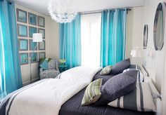 Shared Bedroom. Shared Bedroom Furniture Ideas. Turquoise and navy kids' bedroom features metal convex mirrors illuminated by white sconces placed over a pair of white lacquered twin beds dressed in white and navy bedding placed under an Ikea PS Maskros Pendant Lamp. Shared kids' room boasts a gray damask corner reading chair and a turquoise accent table placed in front of a wall of gray distressed mirrors flanked by windows dressed in turquoise curtains. #SharedBedroom Jean Liu Design.