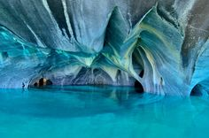 The eerie, azure-colored Marble Caves in Chile are carved into a peninsula of solid marble in a glacial lake that spans the Chile-Argentina border. They are the result of 6,000 years of wave erosion.