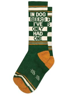 """Funny beer socks feature sporty stripes in cream and mustard on a dark green background with the words, """"In dog beers, I've only had one! Beer Socks, Dog Socks, Funky Socks, Crazy Socks, Man And Dog, Dog Years, Fashion Socks, Unisex, Retro"""