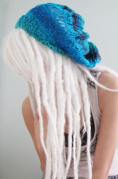 white dreadlocks....I'm personally not a big fan but this is so strange-looking that I wanted to pin it!