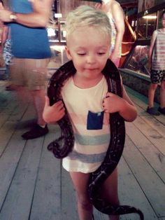 Baby boy with a snake