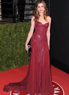 of Dresses of the Year The maroon strapless Versace gown she chose for the Vanity Fair party was the most glam.The maroon strapless Versace gown she chose for the Vanity Fair party was the most glam. Strapless Prom Dresses, Oscar Dresses, Oscar Gowns, Atelier Versace, Elie Saab, Marchesa, Beautiful Dresses, Nice Dresses, Awesome Dresses