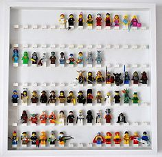Showcase with mini Légo figures (the studs are legos glued) i am so doing this mysonis always complaining he cant find a certain lego man lol Lego Display, Display Case, Vitrine Lego, Boys Room Decor, Kids Room, Lego Room Decor, Room Girls, Legos, Deco Lego