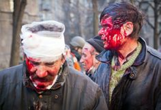 Anti-government protesters are wounded after the clash with the police in Kiev.