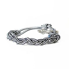 United By Blue. Braided Bracelet Black White. Profits go to removing trash from the ocean :)