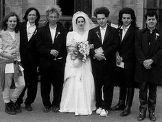 Robert Smith and Mary Poole pose with The Cure on their wedding day in 1988.