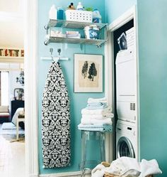 Love this little laundry area.  Mine are going in the space under the stairs....can I fit a fold down ironing board on the back of the door?  Hmmmm.....