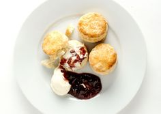 SCONES (ADARE MANOR, IRELAND) 1 1/4 teaspoons baking powder 3/4 teaspoon kosher salt 1 1/2 cups all-purpose flour plus more for work surface 1/4 cup (1/2 stick) chilled unsalted butter, cut into 1/2-inch pieces 1/2 cup whole milk 2 tablespoons sugar 1 large egg, beaten to blend