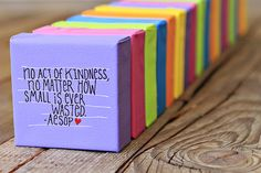 tiny canvases with inspirational quotes -- they handed them out as random acts of kindness. super cute!