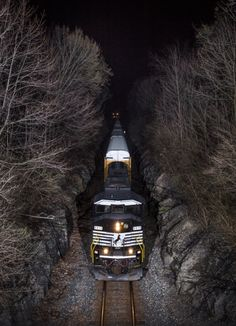 Norfolk Southern 6815 leads autorack train 27K through the small rock cut west of Springfield, Ohio at Milepost 185 on the Dayton District. 6815 is one of nine 3-window SD60M's purchased from BNSF in 2014. The unit was built in 1989 as Burlington Northern 9208. Photo by Brandon Townley. Source Flickr.com