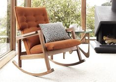 The Risom Rocker ($1,500): Created by legendary Danish designer Jens Risom, this rocker features a straightforward walnut frame with clean lines, a Maharam Milestone fabric upholstered, button-tufted high back and seat, and a hidden counterweight in the front rail to ensure a smooth rocking motion.
