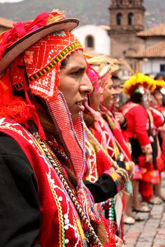 Men dressed in festival costumes in Cusco, Peru