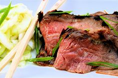 Korean-Style Flank SteakServes 4  ¼ C. sugar¼ C. + 2 T. soy sauce1 T. + 1 tsp. mirin6 large cloves garlic, minced6 scallions, white part only, minced1-inch knob fresh ginger, finely chopped1 T. + 1 tsp. sesame oil1½ lbs. flank steakoil for greasingkosher salt to taste  Whisk together the sugar, soy, mirin, garlic, scallions, ginger and sesame oil until smooth. Transfer to a resealable plastic storage container or a Ziploc bag. Place the meat and let marinate for 3 to 4 hours or overnight.