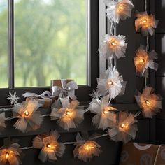 These shimmering ribboned bows with lights make a very fancy statement. #nursery #lighting