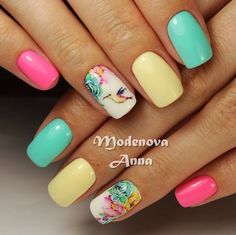 Multicolored rose nail art design. The pastel colors combined together make the ail art design look sweet and charming. Each nail is in different pastel colors which make the entire design look cute and pleasant. #nailart