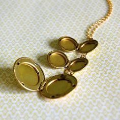"""Triple locket necklace. Each one opens to hold two photographs. Gold plated chain is 25"""", necklace hangs 30"""". lobster clasp. Also available in .999 Fine Silver. $44.00 #jewelry #locket #vintage"""