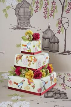 This cake is bursting with colour and originality with deep reds, yellows and greens as well as beautiful hand-painted birds.